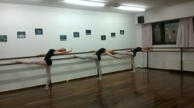 Advanced Foundation students of dance place melissia stretching after their ballet lesson.